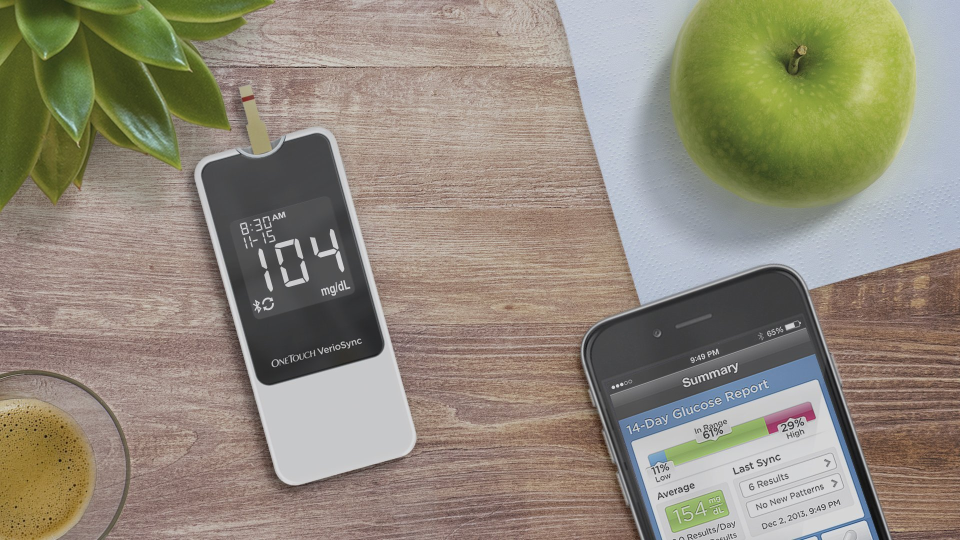 LifeScan OneTouch VerioSync blood glucose test meter next to a smartphone with a supporting app